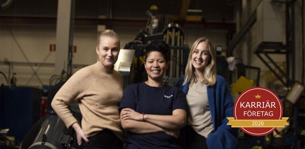 Tre karriärkvinnor från Epiroc - Årets nykomling employer branding - står tillsammans i en verkstad.